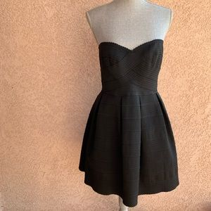 Bandage fit and flare black strapless dress